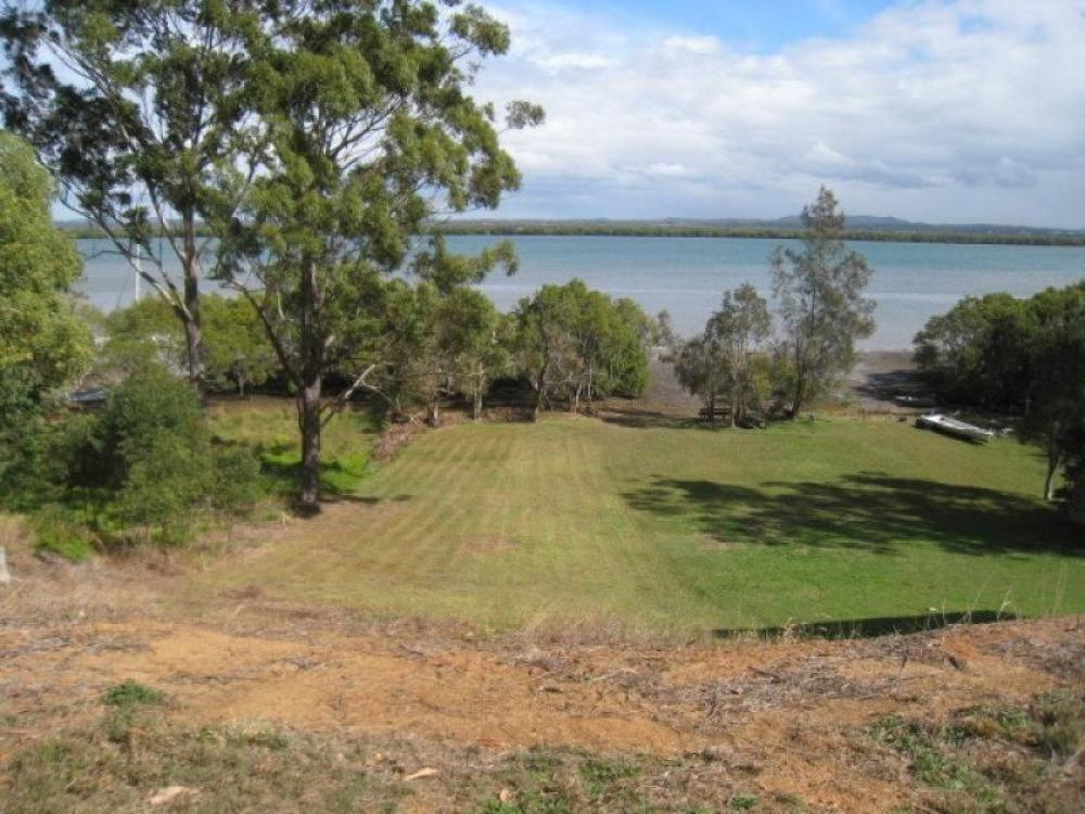 Over a 1/4 acre of sheer waterfront land..Check out the view..!!