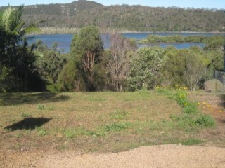 View profile: Large cleared  sloping block with great views over Canaipa passage to Nth Stradbroke Island ...!!!